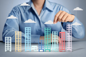 three-ways-to-make-money-in-real-estate-featured-image-buildings-and-clouds